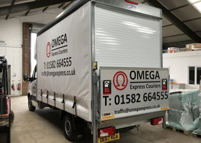 Branded graphics on curtain-sided vehicle